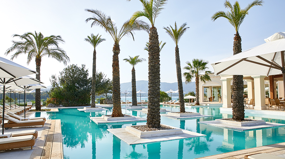Luxury resort in corfu Eva Palace with palm fringed pool
